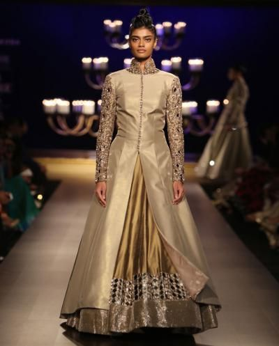 <p>Fashion designer, Manish Malhotra sent his models down the ramp during his 2014 Bridal Collection show in exquisite mirror work <em>lehenga cholis. </em>We loved this jacket that had sleeves and a high neck collar embedded with stunning mirror work. This ensemble would surely make you look super-elegant at any wedding.</p>