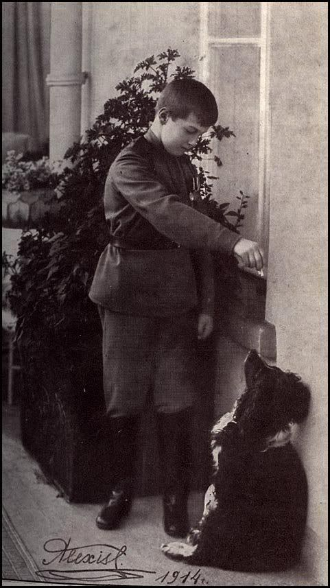 Alexei Romanov with his spaniel Joy. Joy was spared the execution of his master and was later rescued by soldiers of the White army. He was eventually taken to England.