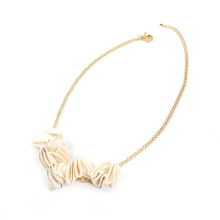 Necklace featuring leather, chain and golden brass. Jewels have interesting and voluptuous shapes, they are handmade, engraving and pleating colored leather elements, which, attached, create small or big ruffles. Piece is soft to the touch.