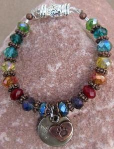 Personalized Rainbow Bridge Pet Memorial Bracelet - Handstamped pet's name on the front, short message engraved on the back. Magnetic paw print clasp for ease of putting on and taking off.  Auntie Angel Designs, $49.50, with a donation to charity.