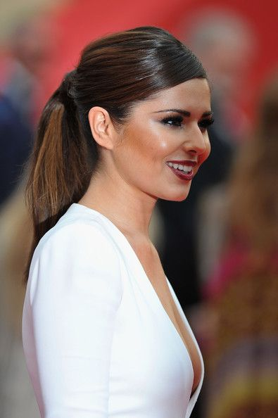 Cheryl Cole Ponytail - Cheryl Cole added a sleek touch to her look with a ponytail that was pinned at the center.