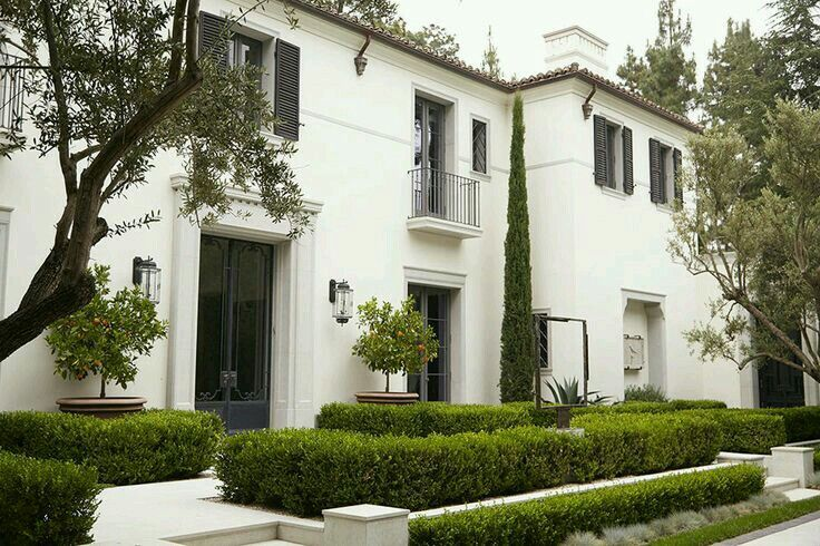 Co Co's Collection : Formal garden # structure # roses # boxwood Italian Cypress Juliet balconies and boxwood embellish this European style home