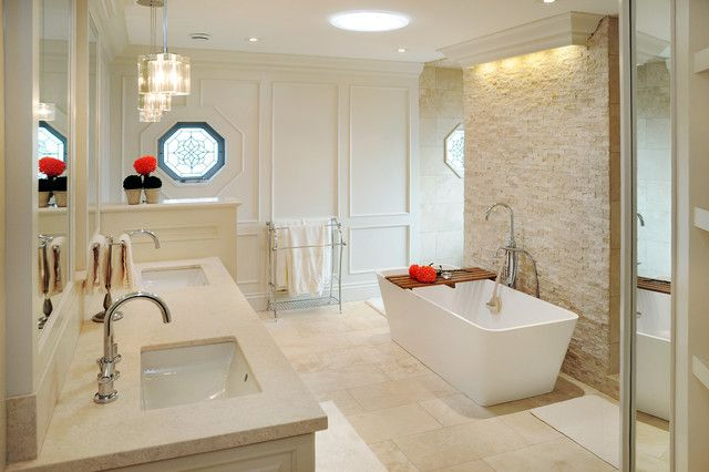 Beige doesn't have to be boring like this classically elegant bathroom with free standing soaking tub. #bathrooms #tile