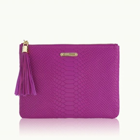 GiGi New York All In One Bag Python Clutch GiGi New York All In One Bag. Not monogrammed!  Gorgeous magenta/jewel tone purple color. Full-grain embossed python leather. Adorable tassel on zipper. Used maybe 3 times - still in GiGi bag and like-new condition! Looks so cute as a little pop of color with any outfit  GiGi New York Bags Clutches & Wristlets