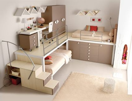 Living in a small space (with moderately high ceilings.) One bed rests on a platform above storage cabinets and drawers. Another bed pulls out from beneath platform that holds desk and tall storage cabinets / closets.
