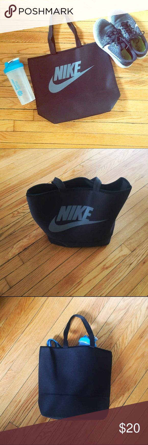 Nike tote/gym bag Nike polyurethane tote bag, perfect for trips to the gym or grocery store. In good used condition with no signs of wear. Measures 14' x 12' x 6'. Bundle for 25% off! Nike Bags Totes