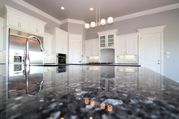 Couto Contemporary Kitchen Blue Pearl Granite, Pure White Cabinets, Zircon Wall Color, Stainless appliances