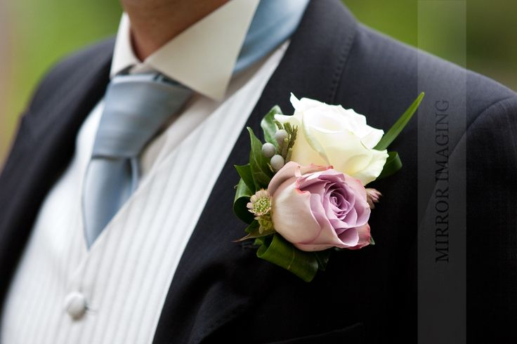 Pinstripe waistcoat and a double rose buttonhole