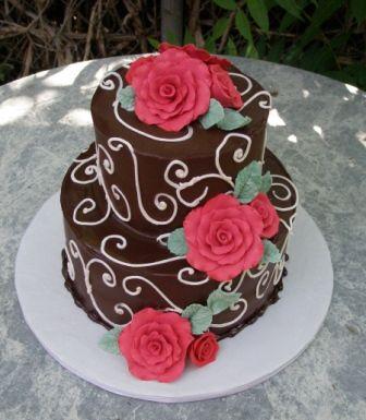 chocolate wedding cake with flowers and swirls -