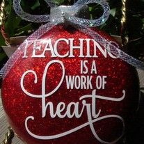 "This+listing+is+for+one+4""+glittered+glass+m&m+shaped+ornament+that+will+make+a+great+teacher's+gift.++The+quote+is+""Teaching+is+a+work+of+heart.""++The+detail+is+done+with+top+quality+vinyl,+and+comes+with+a+coordinating+bow+attached+at+the+top.+++It+has+its+own+box+for+gift+giving+and+storage.++..."
