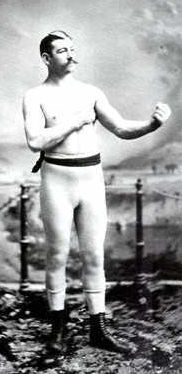 John Lawrence Sullivan  (October 15, 1858 – February 2, 1918), also known as the Boston Strong Boy, was recognized as the first Heavyweight Champion of gloved boxing from February 7, 1881 to 1892, and is generally recognized as the last heavyweight champion of bare-knuckle boxing under the London Prize Ring rules. He was the first American sports hero to become a national celebrity and the first American athlete to earn over one million dollars.