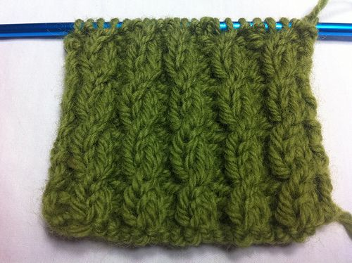 twisted cable stitch, k2 P2 ribbing with a twisted stitch every third row  Don't need a cable needle
