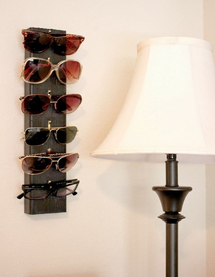 An easy diy project to hang all your sunglasses you just need some picture hangers and a piece of wood!