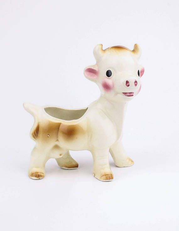 60's cow planter in my Etsy shop https://www.etsy.com/ca/listing/573644622/60s-ceramic-cow-planter-kitsch-home