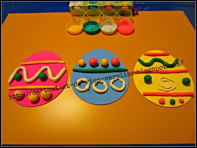 "Decorating egg shapes with playdough - great for motor skills ("",)"
