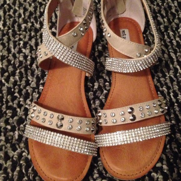 Bling sandal Very cute bling sandal zips in the back with very cute comfy straps! Worn once but they aren't the correct size looking to sell so I can buy a bigger size! :) Not Rated Shoes