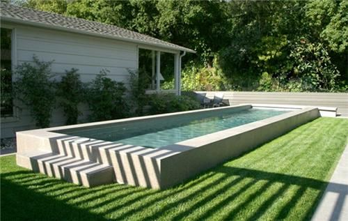 Raised Lap Pool, What about a partially raised pool so that one can sit on the side. Maybe using rough rock on the vertical face, strafing it with light at night.