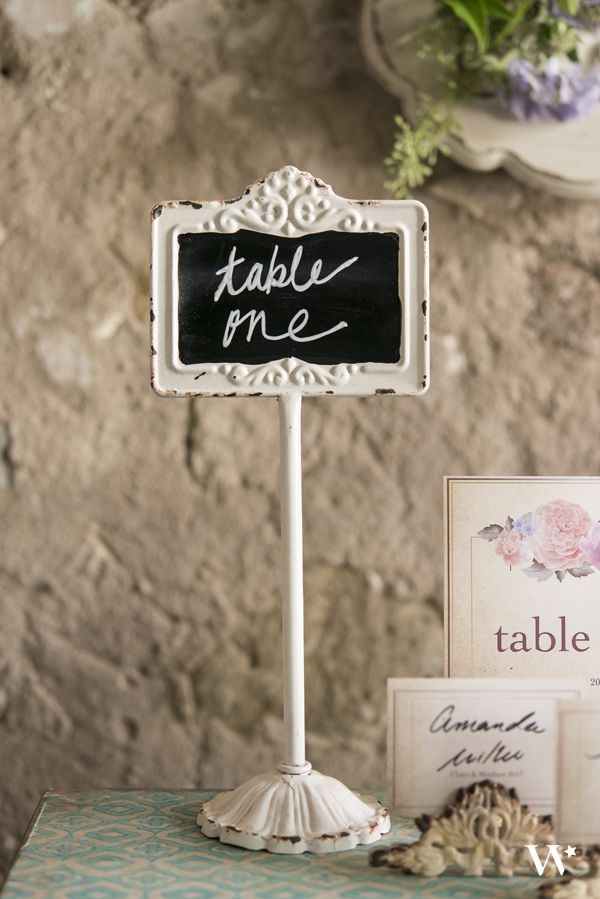 Chalk board table numbers are a fun and rustic touch to your wedding table decor.  These versatile standing chalkboard signs with an antique white frame are perfect as table numbers, or set them out at your candy bar to display the names of the sweet treats.