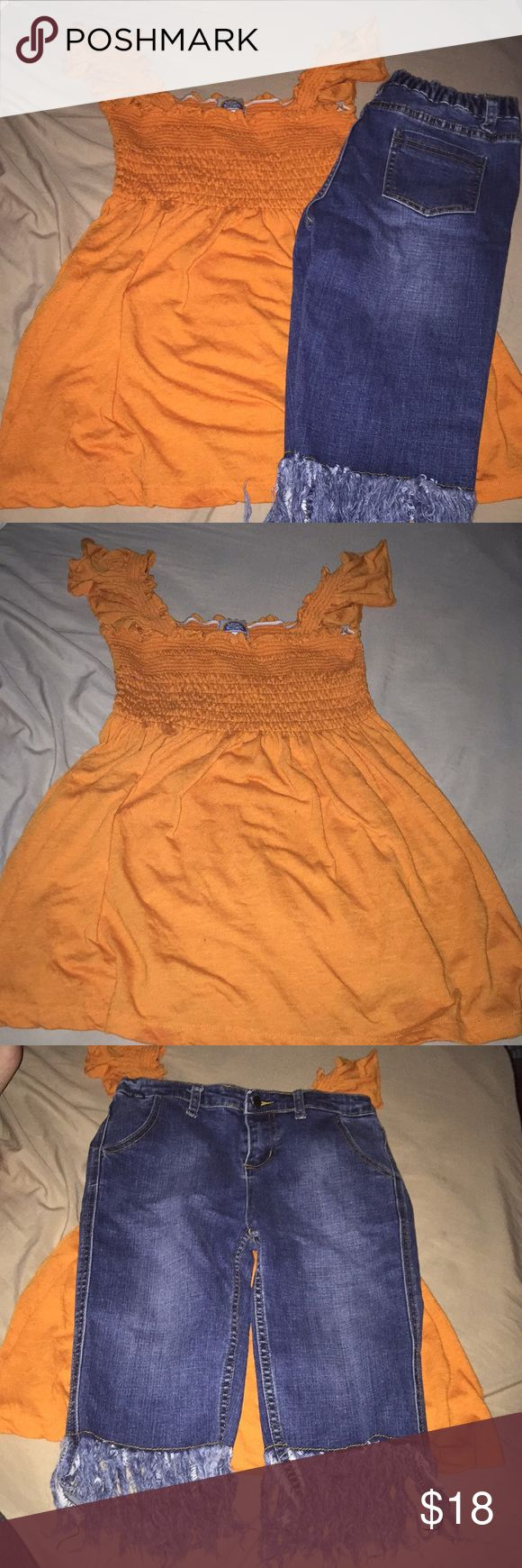 Cute Little Girls Outfit Size 13-14 Adorable little girls outfit in great condition. The shirt is by Love Rocks and is a great orange color. The shorts are Bermuda shorts with like fringes at the bottom. They are Hayden Girls brand and are in excellent condition. Both are size 13-14. From a pet free smoke free home. Love Rocks Matching Sets