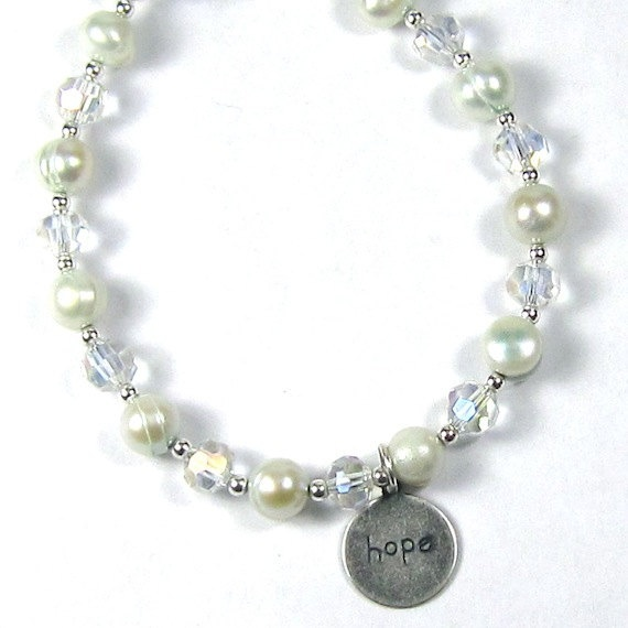 """Bracelet of Light Blue Pearls, Very Light Blue Tinted """"Pearls of Hope for Haiti"""" Pearl and Crystal Bracelet. $25.00, via Etsy. #follow"""