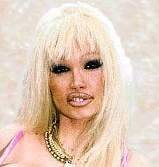 Lolo Ferrari - European Pornographic film star. Cremated, Location of ashes is unknown.