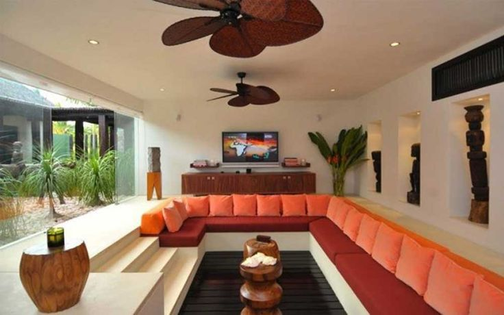 Decorating Ideas for Long Living Rooms with  beige walls and white floor tiles fitted long orange sofa two ceiling fan