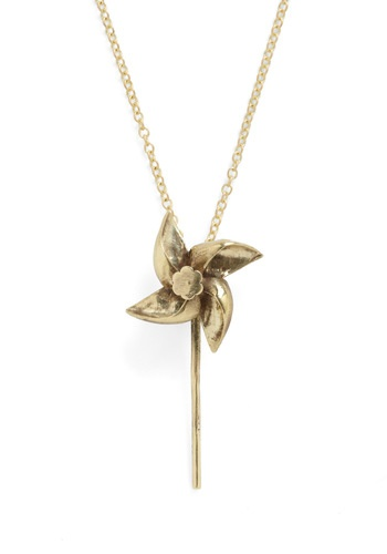 This quirky little brass pinwheel pendant is whimsical and adorable. And yes, it really spins!
