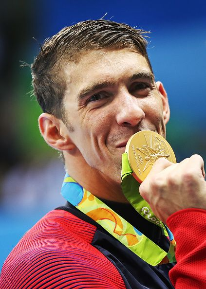 Michael Phelps of United States poses with his Gold medal from the Men's 4 x 100m Freestyle Relay during Day 2 of the Rio 2016…