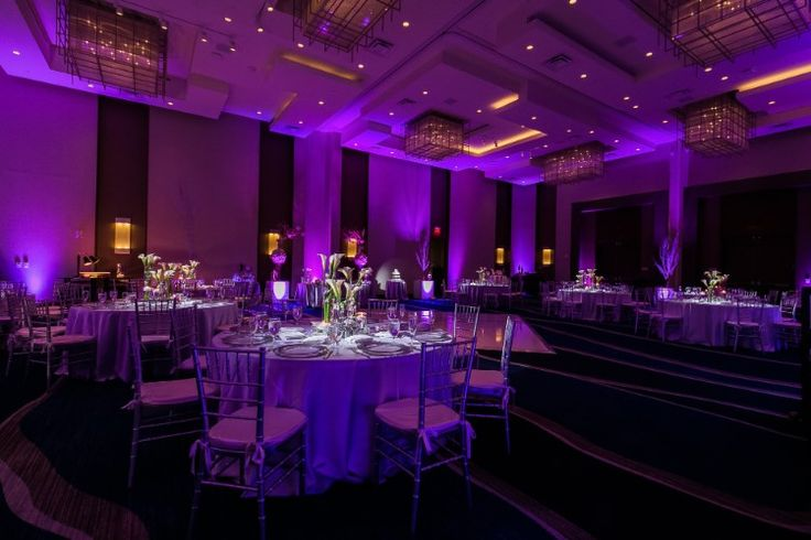 Romantic ballroom wedding reception with purple uplighting (Chris Kruger Photography)