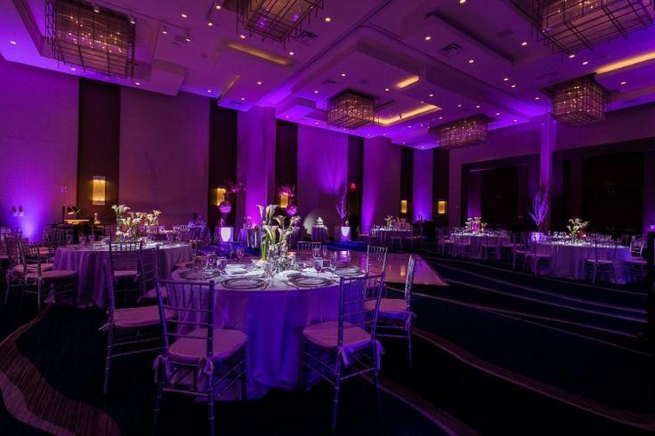 Romantic ballroom wedding reception with purple uplighting (Chris Kruger Photography)