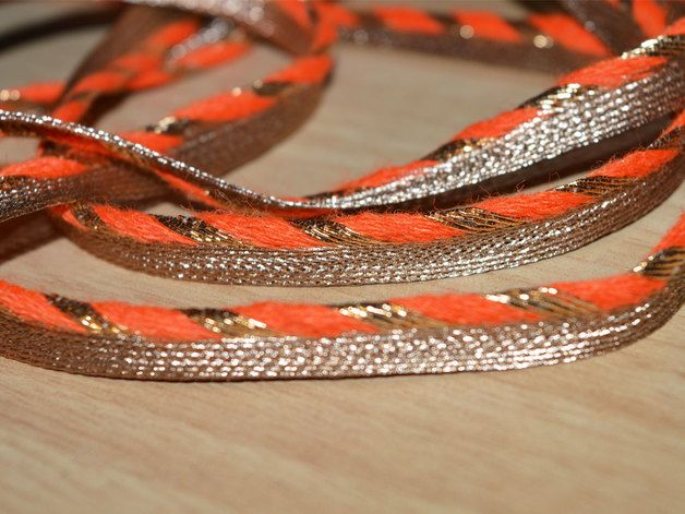 Edge finishing Orange Gold Gota Patti Piping Cord for dresses, cushions covers and pillow covers. It is 0.3 inches wide and is embellished with gold gota work. This is traditional rajasthani gota...