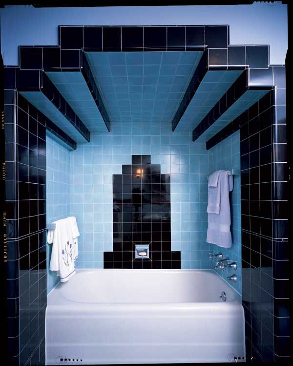 Art Deco Bathroom.  Note the strong contrast of colour, and the bold framing of the bath in black tiles.