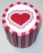 Nice little picture tutorial from Polymer Clay Central Heart Cane