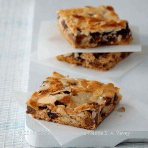 Recipe - Magic Layer Slices - Sprinkle over the chocolate drops.  dried cranberries.
