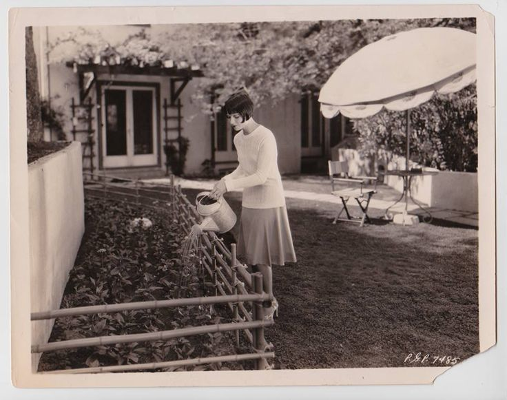 Louise Brooks watering the garden at her Laurel Canyon home in Los Angeles, circa 1927/1928.