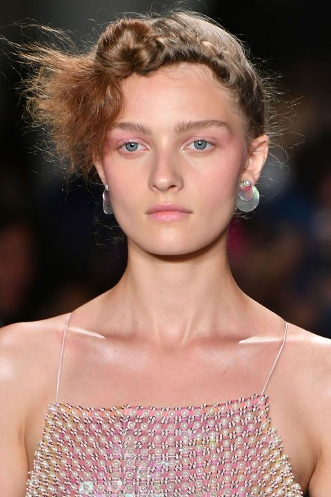 You can blame it on Stranger Things. The '80s are back and they're fresher than ever; just look at the glowing pink makeup seen backstage at Adam Selman. After prepping and moisturizing the skin, makeup artist Emi Kaneko traced a rosy, multipurpose cream color (MAC Casual Color in For Your Amusement) across the cheekbones, up toward the eyes, and all over the eyelids, giving that distinct '80s draping effect. The color was also dabbed on the lips.