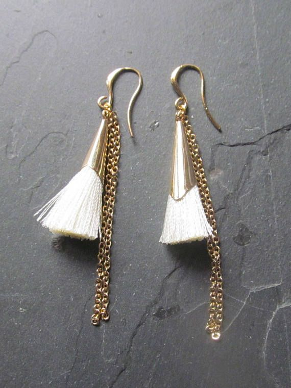 Creamy white tassel earrings with a beautiful gold bead cap that makes this earring cone shaped. Trendy with a boho chic touch , these tassel earrings are the perfect way to make a statement. #bohostyle #tasselearrings  #bohojewelry #bohowedding #bohobride