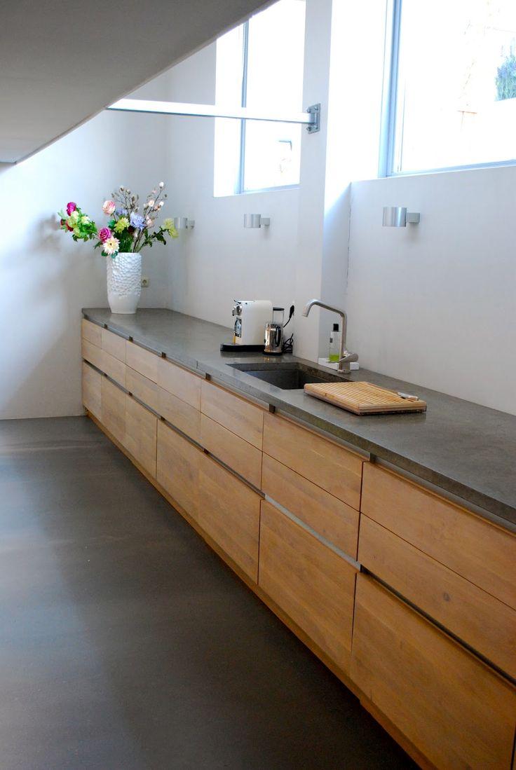 Mix of wood cabinetry and grey countertop  |  Femkeido: Utrechts loft appartement