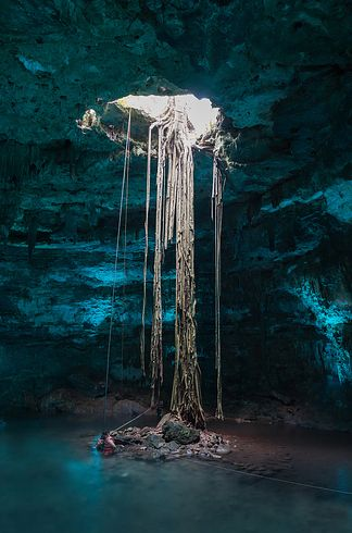 Cenotes of Yucatn Peninsula in Mexico | 27 Surreal Places To Visit Before You Die | These sinkholes in Mexico were formed during the ice age and were held sacred by the Mayans.