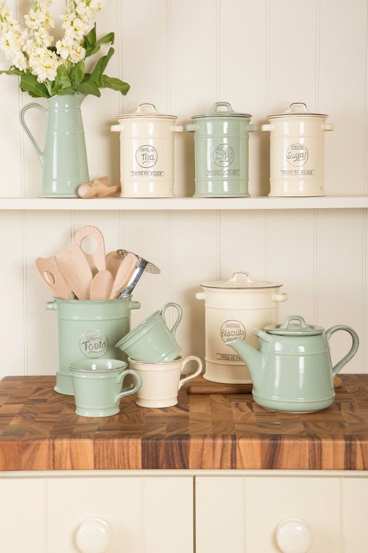 Vintage kitchen storage in rustic cream and rustic green | Image via beautifulkitchensblog.co.uk