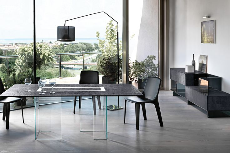 "Table and cupboard consisting of two 12 mm transparent or extralight curved glass bases; top in 15 mm transparent or extralight ""Skinglass"" partially enamelled at high temperature with fabric-effect finish, available in two colours."