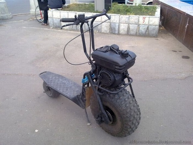 Gas powered scooter. Big wheel in front