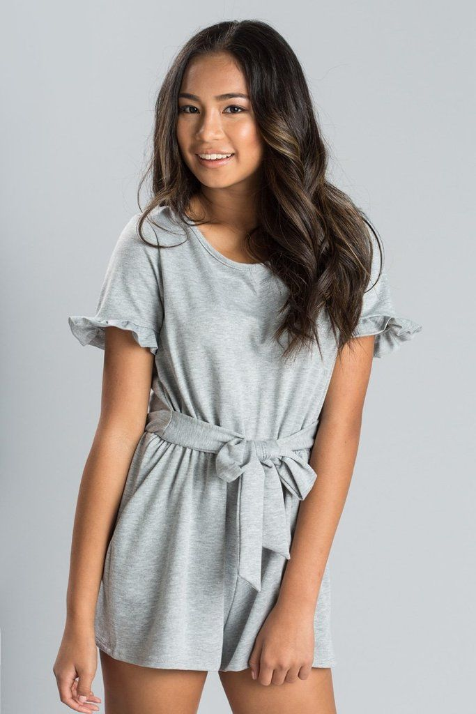 75d99480cca0 We can t decide what part of this romper we love more - the tie front belt  or the cute ruffled.
