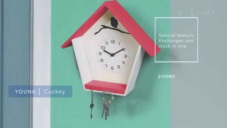 NeXtime - Cuckey - 3109BL / 3109RO  The 'Cuckey' conveniently stores keys and tells the time in a minimalist design with flat, straight lines and sharp edges that create a house icon in its purest form, Made of wood and available in two distinct colors, this key storage and clock in one is perfect for kitchens, hallways and foyers. The magpie in the back of this all-in-one design will closely watch your keys. Available in red and blue.