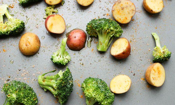 Anti-inflammatory Turmeric Roasted Broccoli & Tri-Color Potatoes Recipe Side Dishes with broccoli, baby potatoes, olive oil, apple cider vinegar, lemon juice, turmeric, cardamom, ground black pepper, salt