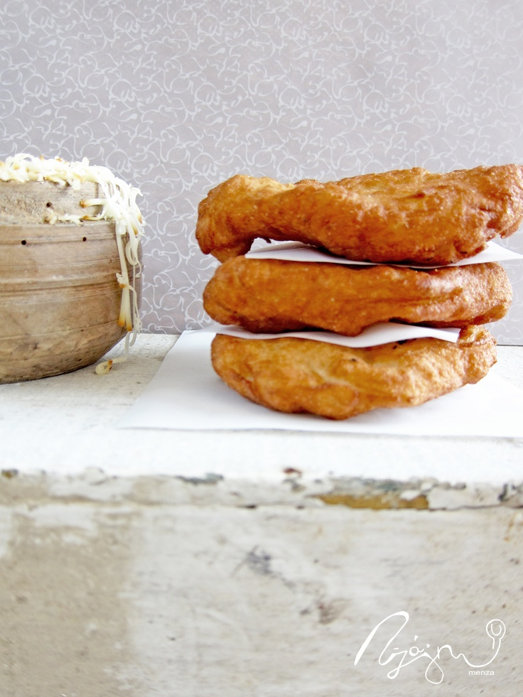 Lángos, a deep fried flat bread made of a dough with flour, yeast, salt and water.