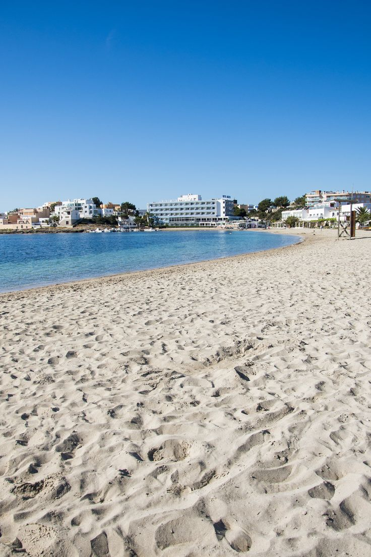 Talamanca, the closest beach in proximity to Ibiza town. The long wooden promenade that runs the length of the golden shore is peppered with restaurants and beach bars, making it a great place to set up for either a day on the beach or just a quick lunchtime snack.
