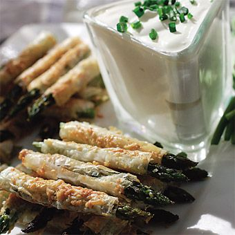 """Brides.com: Dawn and James in San Francisco, CA. Hors d'oeuvres included these California-grown asparagus """"straws,"""" which were wrapped in delicate phyllo dough, dusted with Parmesan cheese, and served with a citrus crème fraîche. Catering by Alex's Catering."""