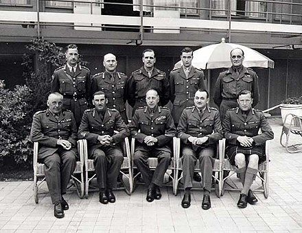 First Canadian Army generals in Hilversum, the Netherlands, on May 20, 1945 Seated from left: Stanisław Maczek (Polish Army), Guy Simonds II Canadian Corps, Harry Crerar 1st Canadian Army, Charles Foulkes I Canadian Corps, Bert Hoffmeister 5th Canadian (Armoured) Division; Standing from left: Ralph Keefler 3rd Canadian Infantry Division, Bruce Matthews 2nd Canadian Infantry Division, Harry Foster 1st Canadian Infantry Division, Robert Moncel (for Chris Vokes 4th Can Div