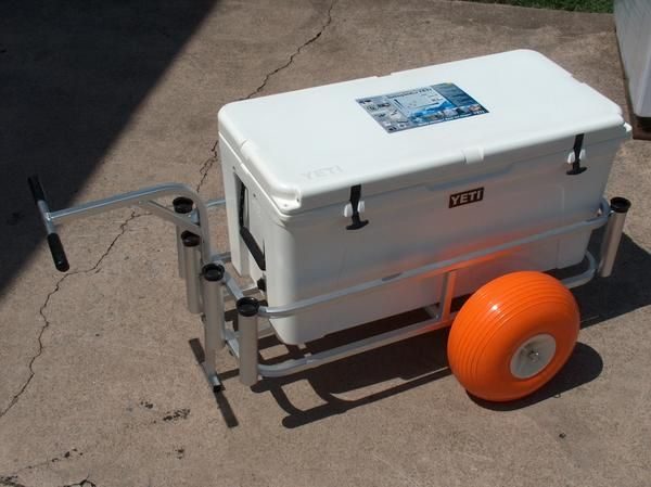 """This is the fishing cart for Yeti coolers. The wide fishing cart features an anodized aluminum finish which means you will enjoy it for years without corrosion. Fish N Mate comes standard with a lifetime limited warranty unlike it's competitors. Fish-N-Mate employs 20 years of surf fishing knowledge into every pier cart they build. Fishing Cart Features:  Balloon tires Wide body for Yeti coolers 8 rod holders Cutting board Bait basket  Fishing Cart Dimensions:  19"""" wide and 43 """" long Balloon…"""